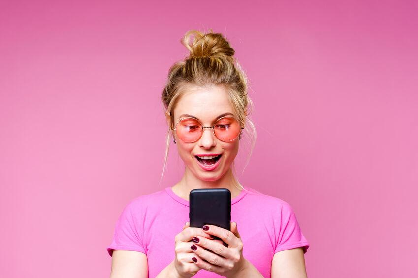 Girl using spiritual dating app